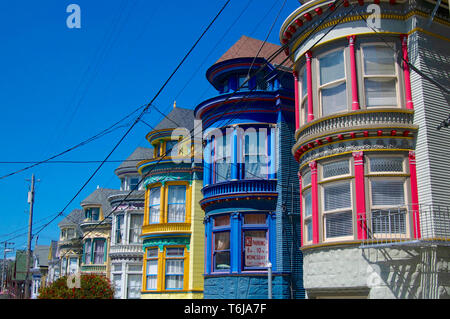 San Francisco, California, USA - 24th May 2015 : Beautiful colored houses of the hippie district of Haight & Ashbury in San Francisco, USA - Stock Photo