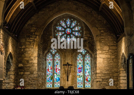 Stained glass window in a chapel - Stock Photo