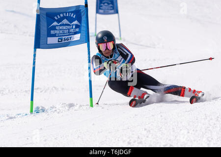 KAMCHATKA PENINSULA, RUSSIA - APRIL 1, 2019: Mountain skier Svitkov Gennady (Kamchatka) skiing down mountain slope. Russian Alpine Skiing Cup, Interna - Stock Photo
