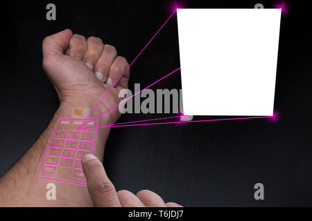 Implanted SIM and telephone under the skin project a copy space for image o text - Stock Photo