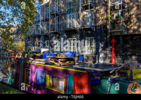 LONDON, UK – Oct 21, 2018: Rows of houseboats and narrow boats on the canal banks at Regent's Canal next to Paddington in Little Venice, London - Stock Photo