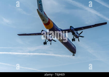 London, UK - 17, February 2019: Flybe a British regional airline based in England, aircraft type De Havilland Canada DHC-8-400 Fly on blue sky. - Stock Photo