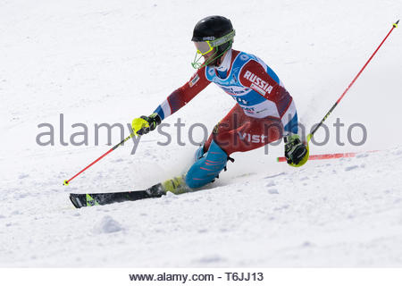 MOROZNAYA MOUNTAIN, KAMCHATKA, RUSSIA - MAR 29, 2019: International Ski Federation Championship, Russian Alpine Skiing Championship slalom. Mount skie - Stock Photo