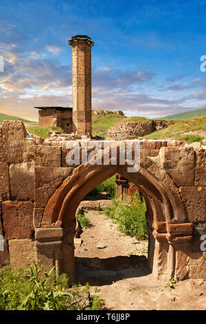 Medieval Gothic Door Arch infront of The Seljuk Turk Mosque of Ebul Minuchihr (Minuchir) built in 1072, Ani archaelogical site on the ancient Silk Roa - Stock Photo