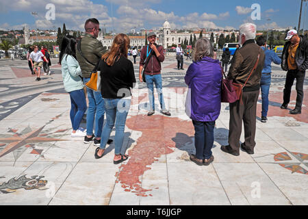 Tour guide talking to tourists on the map near Padrao dos Descobrimentos Monument to the Discoveries Lisbon Lisboa Portugal Europe EU KATHY DEWITT - Stock Photo