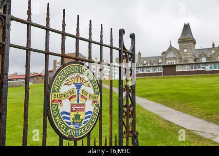 LERWICK, SHETLAND ISLANDS, SCOTLAND, UK -  AUGUST 20, 2017: Painted sign on metal doors as entrance into Anderson High School in Lerwick, Shetland Isl - Stock Photo