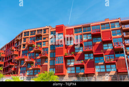 Newly built red multi-family apartment house seen in Berlin, Germany - Stock Photo