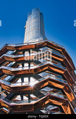 New York City, NY / USA - April 01, 2019: The vessel, a modern art, honeycomb like staircase in the center of the Hudson Yard open for visitors on a s - Stock Photo