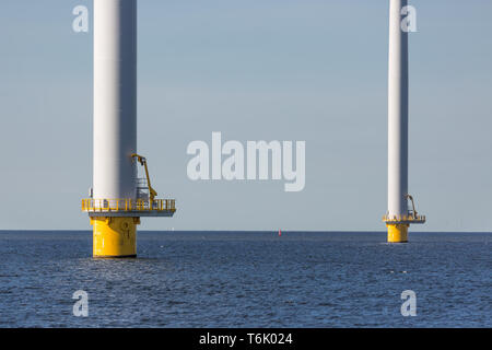 Foundation of big wind turbines in the sea - Stock Photo