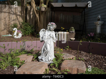 Honoring beloved family members in a memorial Garden set up in a yard at a private home in South Carolina. - Stock Photo