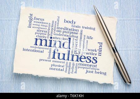 mindfulness word cloud - handwriting on a sheet of rough Khadi paper - Stock Photo