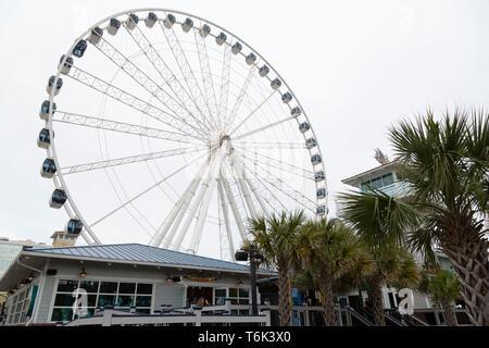 Myrtle Beach Sky Wheel in South Carolina, USA. The wheel offers views over the coast. - Stock Photo