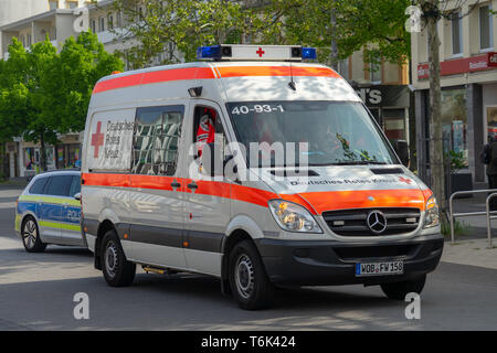 Wolfsburg, Germany, May 1, 2019: A van of the car brand Mercedes Benz drives on the demonstration train for May 1st as ambulance service. - Stock Photo
