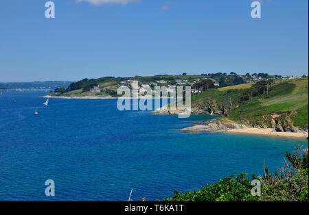 View from the coastal path on St Anthony's Head towards  Henry VIII's coastal artillery fortress of St Mawes castle in Cornwall, England ,UK - Stock Photo