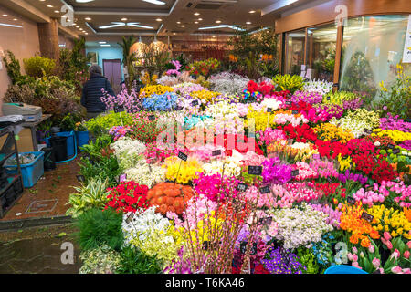 Osaka, Japan - 3 Mar 2018; A lot of Flowers were arranged and sold in flower shop at Kuromon Ichiba Market (fish market), Osaka, Japan. - Stock Photo