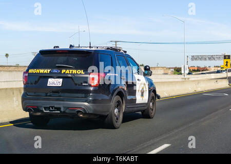 April 22, 2019 Hayward / CA / USA - Police car driving on the freeway in East San Francisco bay area - Stock Photo