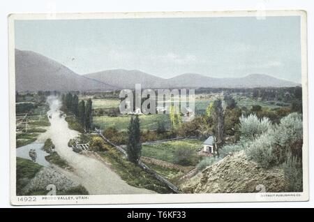 Detroit Publishing Company vintage postcard depicting homes and fields with peaks in the distance, in Provo Valley, Utah, 1914. From the New York Public Library. () - Stock Photo