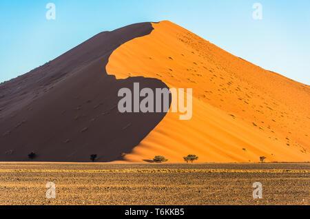 Red dunes in Sossusvlei, Namib-Naukluft National Park, Namibia - Stock Photo