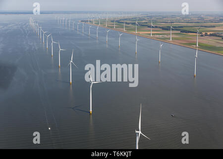 Aerial view Dutch sea with offshore wind turbines along coast - Stock Photo