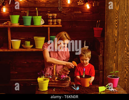 farm. green house farm. mother and son working at home farm. farm and farming concept. making the world green - Stock Photo