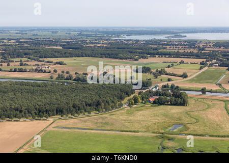 Aerial view Dutch polder Noordoostpolder with woods en agricultural fields - Stock Photo