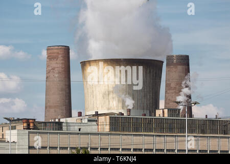 Cooling tower and smokestack coal fired power plant in Germany - Stock Photo