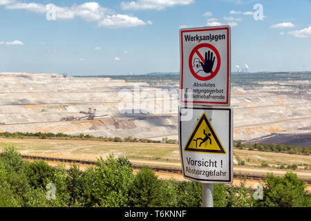 Warning sign near open pit mine Hambach in Germany - Stock Photo