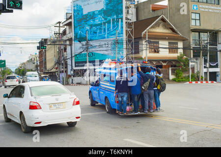 CHIANG MAI, THAILAND - JANUARY 17, 2017: People on overloaded city bus in Chiang Mai. Chiang Mai is the second largest city in Thailand - Stock Photo