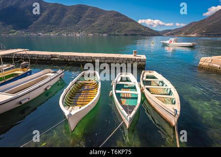 Three small fishing boats in a Kotor bay - Stock Photo