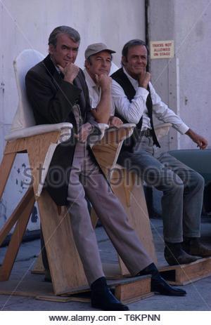 Gene Kelly, Henry Fonda and James Stewart on the set of The Cheyenne Social Club 1970.. Credit: 356917Globe Photos/MediaPunch - Stock Photo