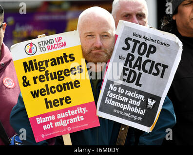 An anti racist protestor confronting The English Defence League - Stock Photo