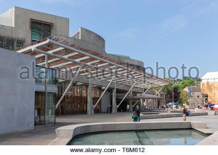 Square with pond in front of Scottish Parliament building Edinburgh. - Stock Photo