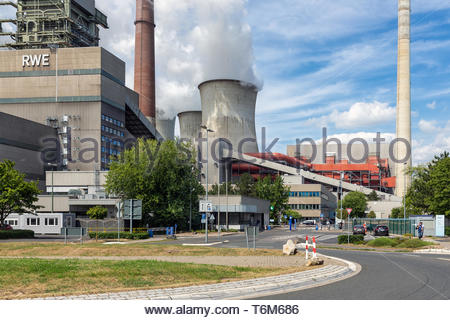 Workers leaving factory gate coal-fired power plant Frimmersdorf in Germany - Stock Photo