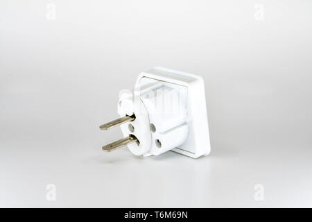 Close up view of a mains power travel adapter plug for the USA isolated against a plain white background. - Stock Photo