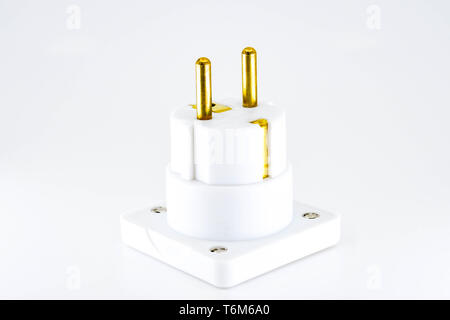 Close up view of a mains power travel adapter plug for European countries isolated against a plain white background. - Stock Photo