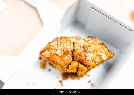 Box from store storebought bundt cake carrot or pumpkin halloween autumn christmas season macro dessert showing detail and texture - Stock Photo