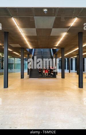 LONDON, UK - APRIL 1, 2019: People in interior of Tate Modern Turbine Hall in London - Stock Photo