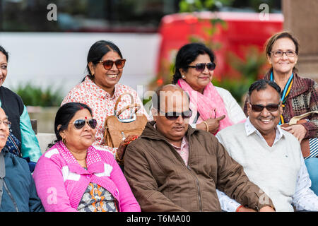 London, UK - September 12, 2018: Westminster area with Parliament Square Garden and many Indian people sitting by Gandhi monument during day - Stock Photo