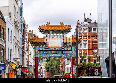 London, UK - September 12, 2018:Chinatown China town Wardour street road in downtown city with Chinese red colorful building gate - Stock Photo