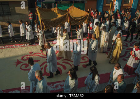 Sao Manuel, Brazil. Religious procession passing by a colorful sand carpet at the Holy Week on street of Sao Manuel, a little town in the countryside. - Stock Photo