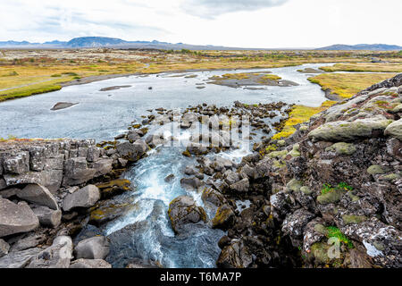 Thingvellir National Park in Iceland Golden circle and small waterfall landscape below called drekkingarhylur - Stock Photo