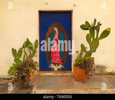 Religious painting of the Madonna on a doorway in the old town, Córdoba, a city in the southern region of Andalusia, Spain - Stock Photo