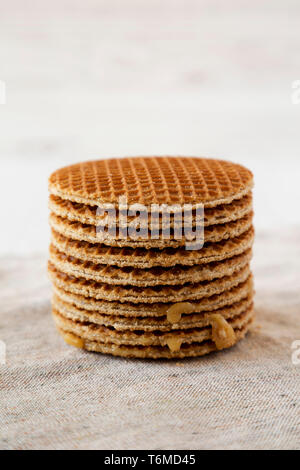 Stack of homemade Dutch stroopwafels with honey-caramel filling, side view. Closeup. - Stock Photo