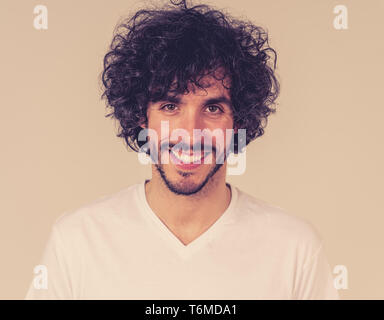 Portrait of attractive young model with happy face, beautiful smile and funny hair style. Handsome millennial man in his 20s. Studio shot. In People,  - Stock Photo