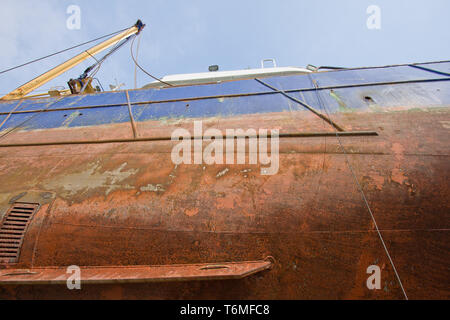 Keel of fishing cutter at a shipyard for maintenance - Stock Photo