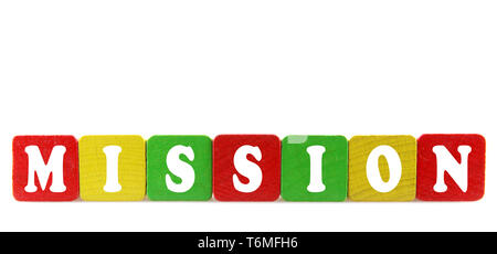 mission - isolated text in wooden building blocks - Stock Photo