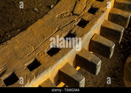 Wooden gear wheels. An ancient wooden rotating gear wheel at the mill. - Stock Photo
