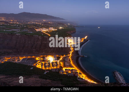 Aerial night view of Tazacorte at Canary Island La Palma - Stock Photo