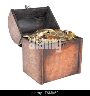 Wooden money chest filled with coins isolated over white - Stock Photo