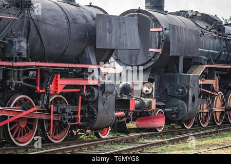 Old disused retro steam black train locomotives - Stock Photo
